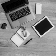 collection of tech and a notebook